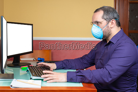 man with medical mask working