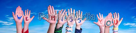 children hands building word we miss