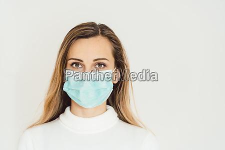woman with corona mask protecting her