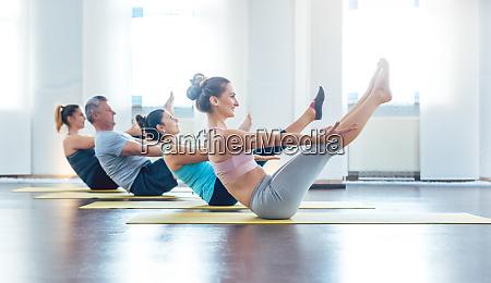 women and men having a yoga