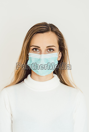 woman with corona mask protecting her