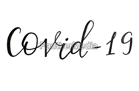 black handwritten inscription covid 19 on