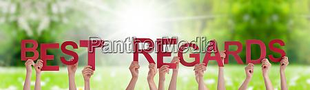 people hands holding word best regard