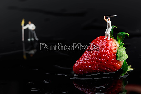 juicy red strawberry on black acrylic