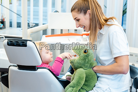 little child in dentists surgery learning