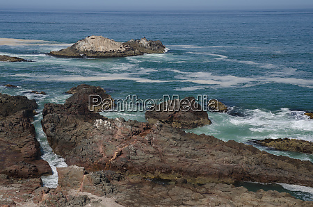 rocky cliff and islet in the