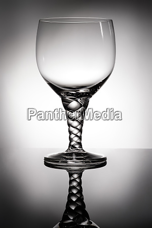 cocktail, glass, with, pigtail, in, backlight - 28258405