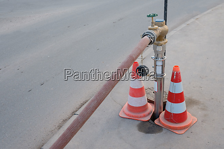water, hydrant, with, hose, at, a - 28258342
