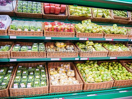 fresh fruits on shelf in supermarket
