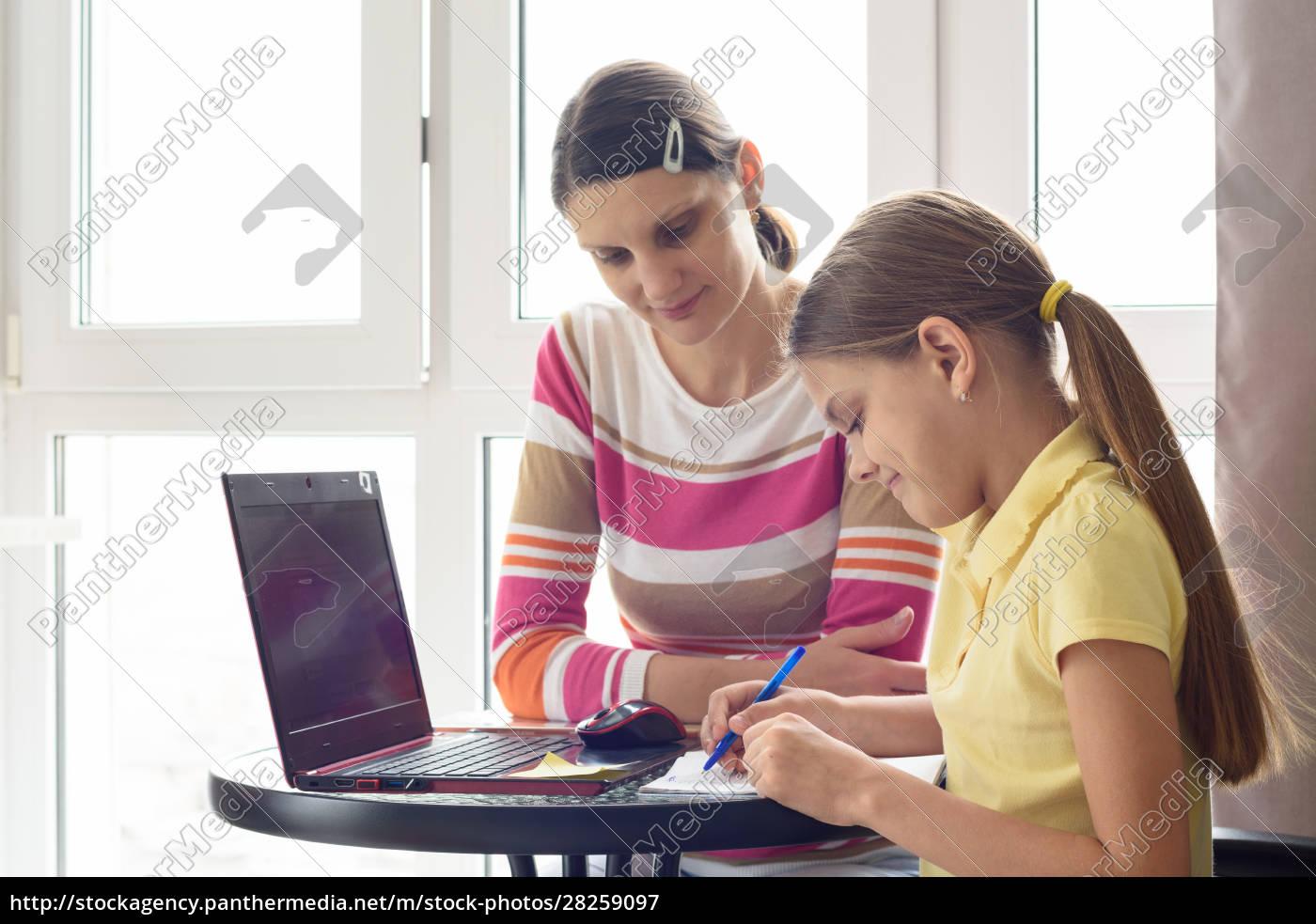 a, tutor, teaches, a, child, at - 28259097