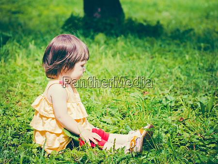 one-year, baby, girl, sitting, on, grass - 28259712