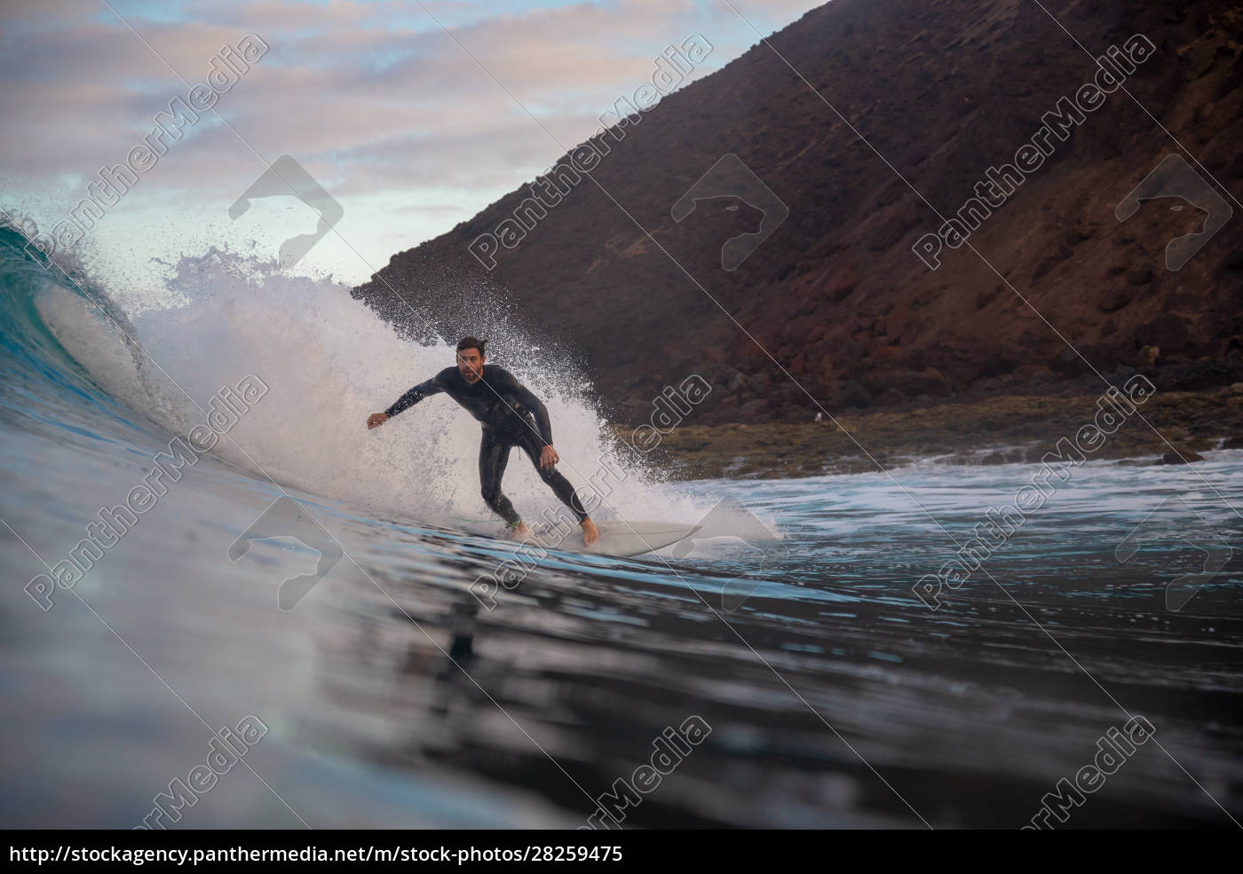surfer, riding, waves, on, the, island - 28259475