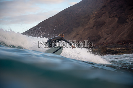 surfer, riding, waves, on, the, island - 28259476