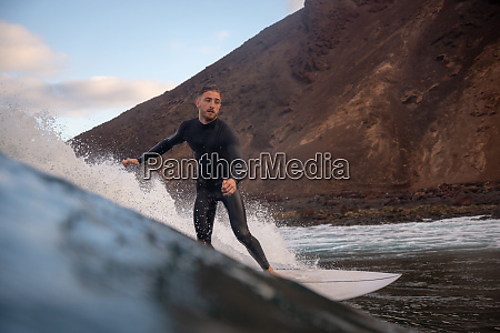surfer, riding, waves, on, the, island - 28259477