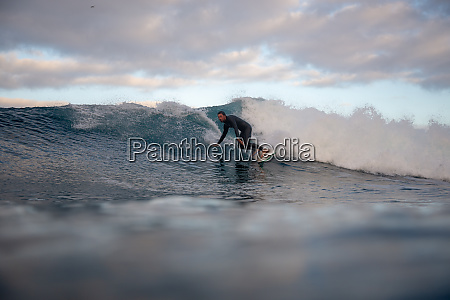 surfer, riding, waves, on, the, island - 28259479