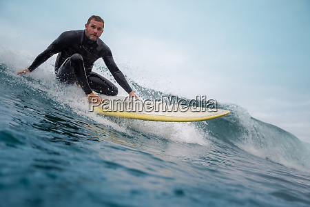 surfer, riding, waves, on, the, island - 28259483