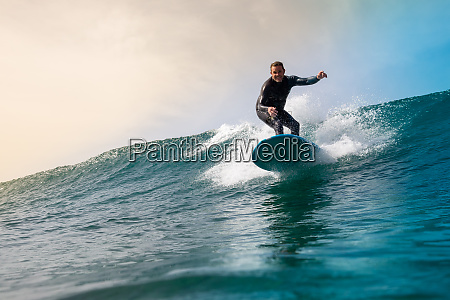 surfer, riding, waves, on, the, island - 28259531
