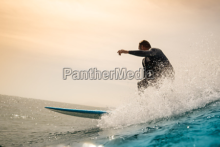 surfer, riding, waves, on, the, island - 28259544