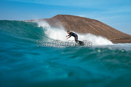 surfer, riding, waves, on, the, island - 28259548