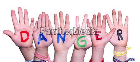 children hands building word danger isolated