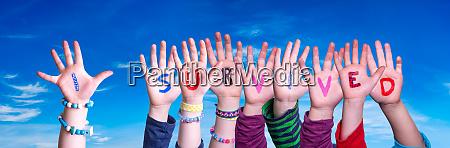 children hands building word i survived