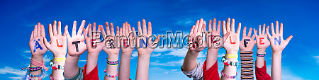 kids hands holding word aelteren helfen