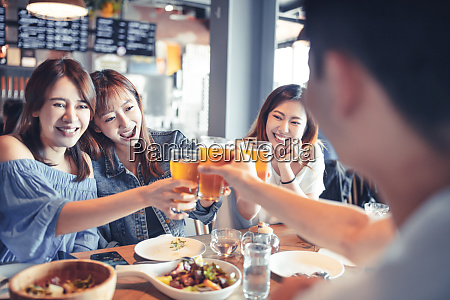happy young group dining and drinking