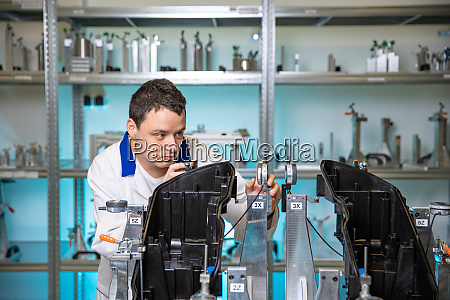 automotive quality engineer performs measurement of