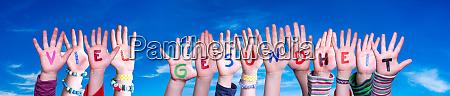 kids hands holding word viel gesundheit