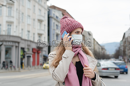 concerned woman using her phone wearing