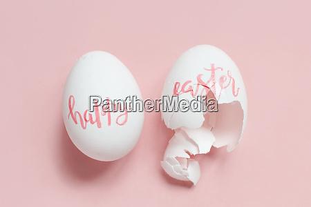 broken eggs with handwritten inscription happy