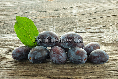 plums with green leaf