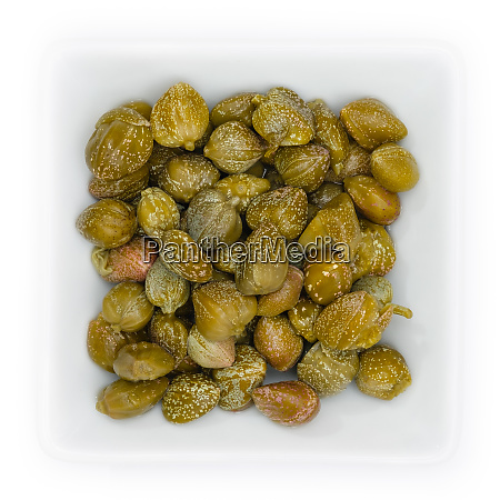 greem capers in a white bowl