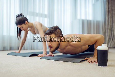 morning fitness training of family couple