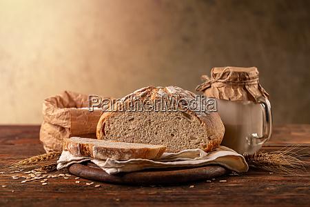 cut loaf of artisanal wheat bread