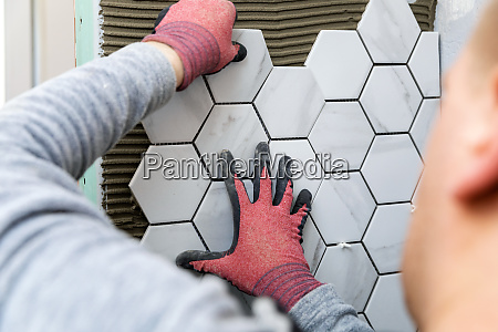 tiling man laying marble texture