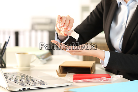 business woman with opened package sanitizing