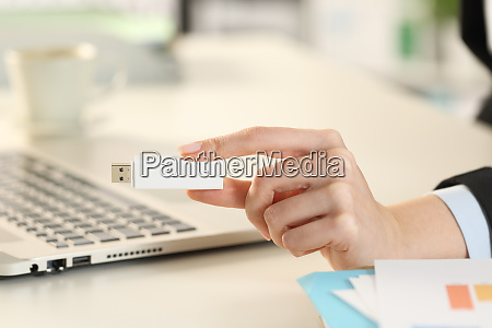 business, woman, hand, showing, pendrive, stick - 28277874