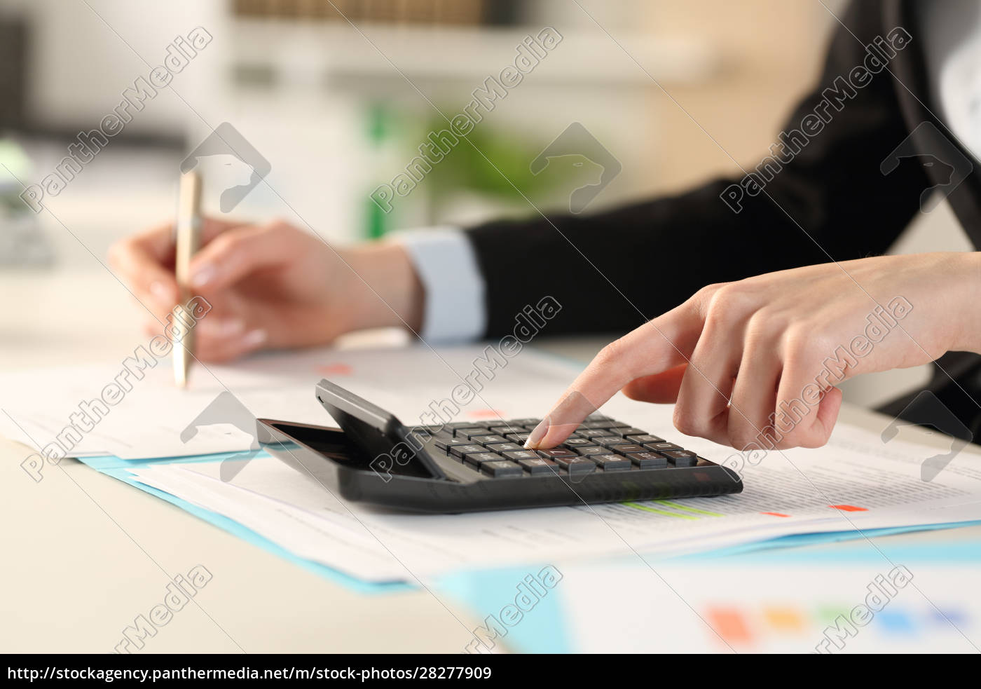 executive, hands, calculating, with, calculator, at - 28277909