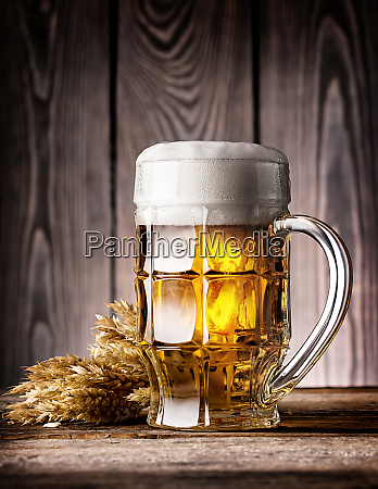 faceted, mug, of, light, beer, with - 28278840