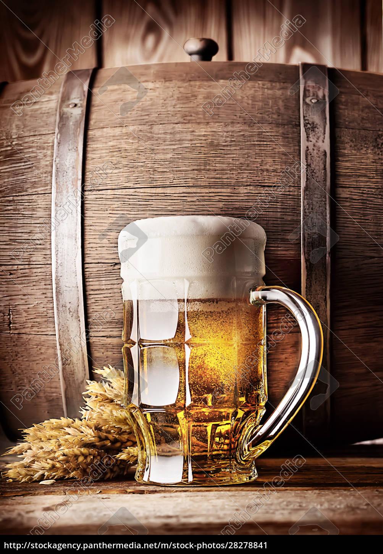 faceted, mug, of, light, beer - 28278841