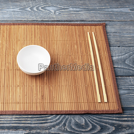 two, wooden, chopsticks, and, a, white - 28278746