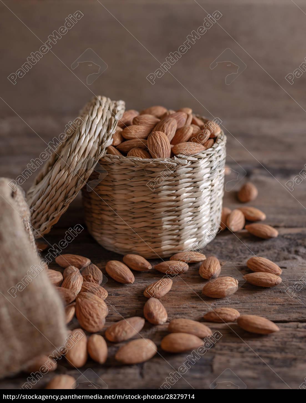 almond, in, basket, on, blurred, wooden - 28279714