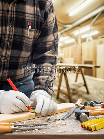 carpenter, at, work, on, wooden, boards. - 28279345