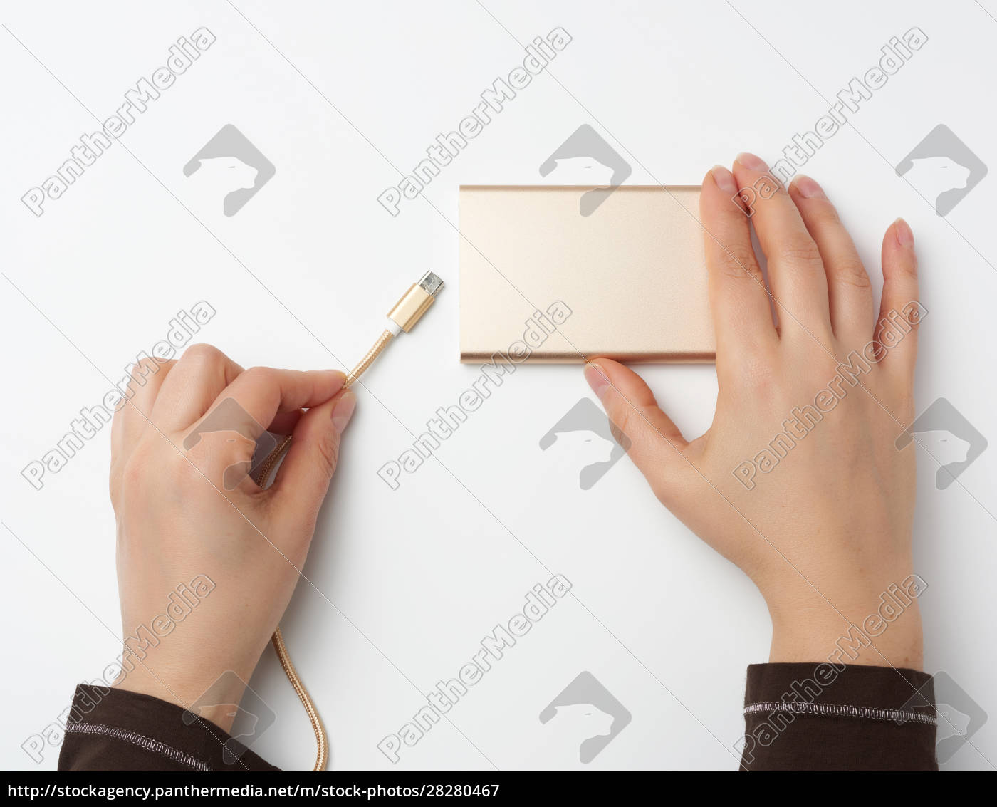 hands, holding, a, portable, power, bank - 28280467