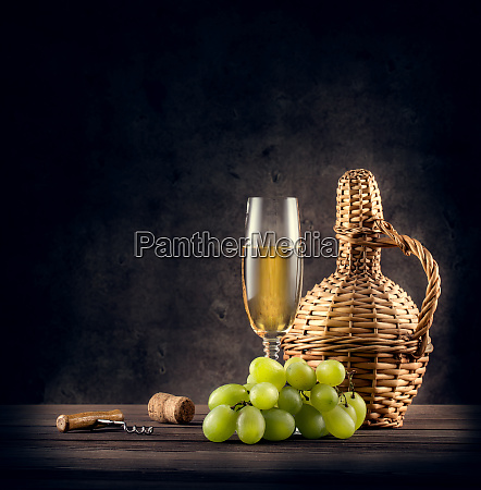 braided carafe and a glass of