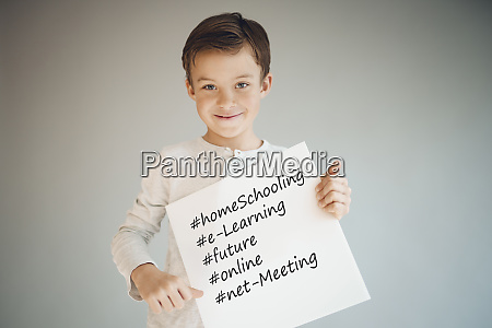 boy holding white sign with the