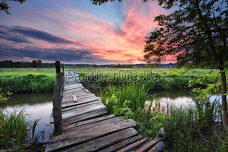 old wooden bridge across the river