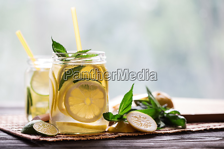 cold lemonade with lemon wedges