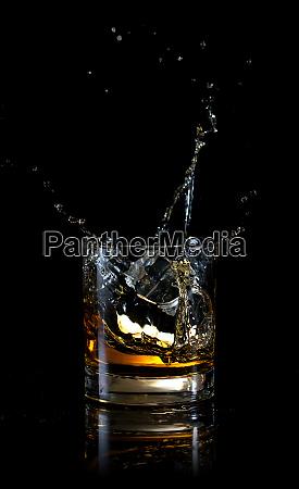 splash of ice in glass of